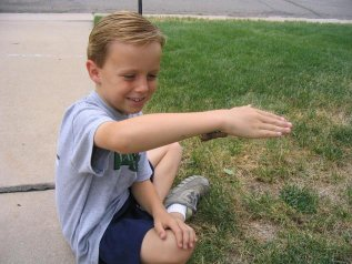 Garrett makes friends with a caterpillar in Colorado - July 2006