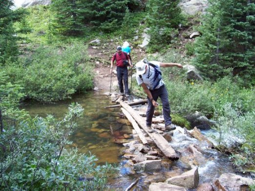 Steve Hoffmeyer and Roger Wendell negotiating a creek in the Holy Cross Wilderness - 08-07-2005