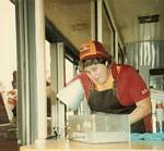 Mary Moreland gives out one of the last orders at Pup 'N' Taco - 1980s